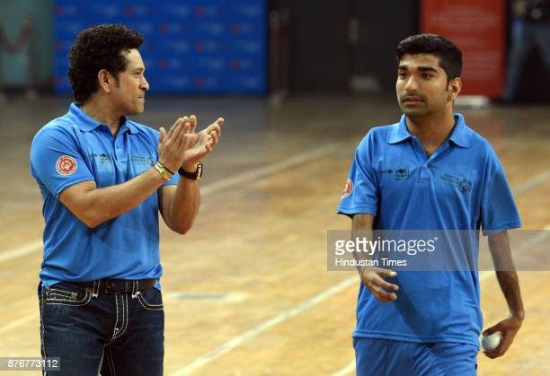 Former Cricket star Sachin Tendulkar appreciate a young players during the Special Olympic Unified Cricket Match to celebrate World Children's Day...