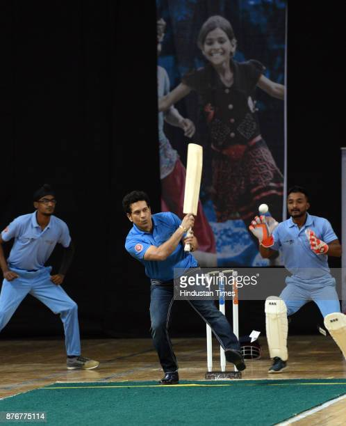 Former Cricket star Sachin Tendulkar bats during the Special Olympic Unified Cricket Match to celebrate World Children's Day organized by unicef at...
