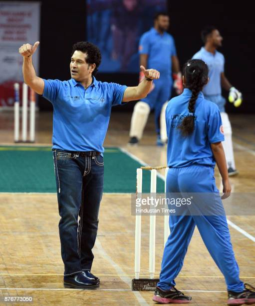Former Cricket star Sachin Tendulkar enjoying the movements during the Special Olympic Unified Cricket Match to celebrate World Children's Day...