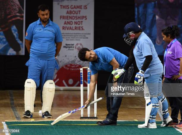 Former Cricket star Sachin Tendulkar giving bating tips to a young players during the Special Olympic Unified Cricket Match to celebrate World...