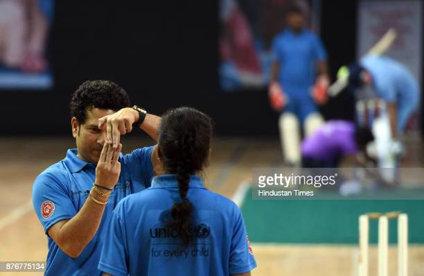 Former Cricket star Sachin Tendulkar giving bowling tips to a young players during the Special Olympic Unified Cricket Match to celebrate World...