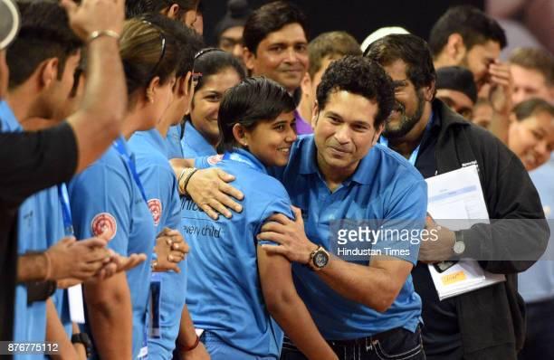 Former Cricket star Sachin Tendulkar interacts with children to celebrate World Children's Day organized by unicef at Thyagraj Stadium on November 20...