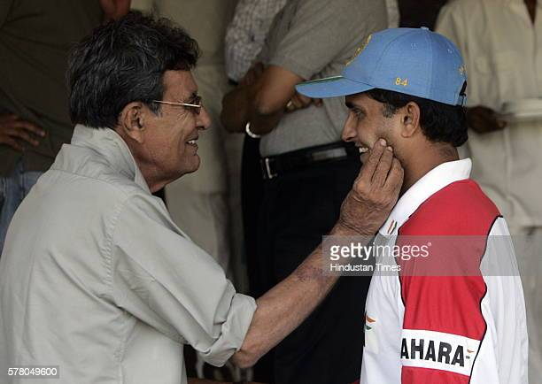 Former cricket test player Salim Durani consoling Saurav Ganguly during the Duleep Trophy match between East Zone and Zimbabwe XI at Brebourne...