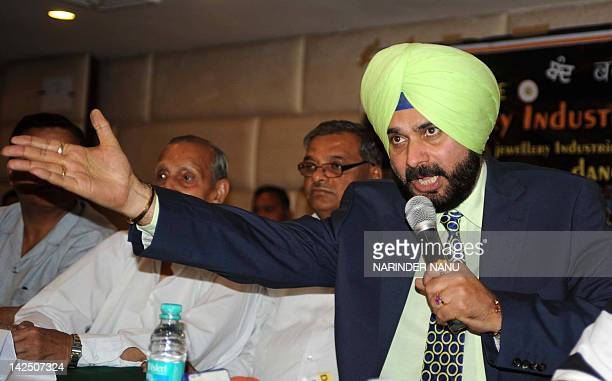 Former cricketer and Bharatiya Janata Party member of parliament Navjot Singh Sidhu addresses members of All India Gems and Jewellery Trade...