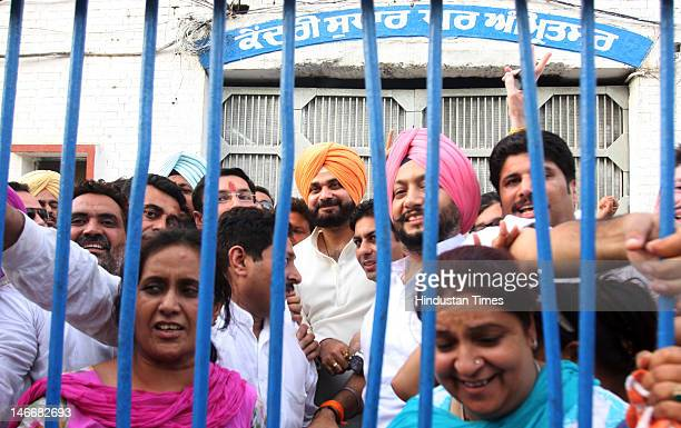 Former Cricketer and BJP MP from Amritsar Navjot Singh Sidhu stands with supporters after leaving Amritsar central jail after his court arrest on...