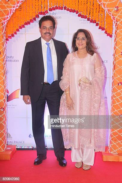 Former Cricketer Dilip Vengsarkar with wife Manali poses for the cameras as they arrive for the Bollywood theme dinner at the Taj Palace Hotel on...