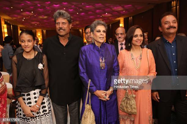 Former Cricketer Kapil Dev with his wife Romi Bhatia and Former Cricketer Madan Lal with his wife Annu during the wedding reception party of...