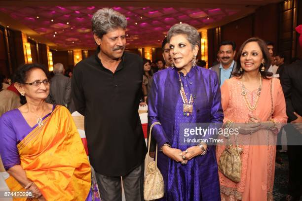 Former Cricketer Kapil Dev with his wife Romi Bhatia during the wedding reception party of Cricketer Yashpal Sharma's daughter Preeti Sharma and...