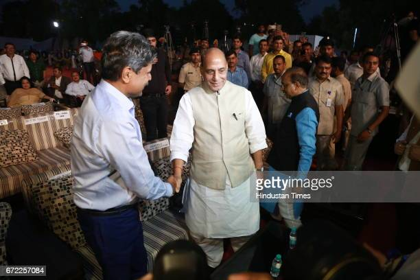 Former cricketer Kapil Dev with Home Minister Rajnath Singh during the launch of Oorja by CAFP U19 Football Talent Tournament at India Gate on April...