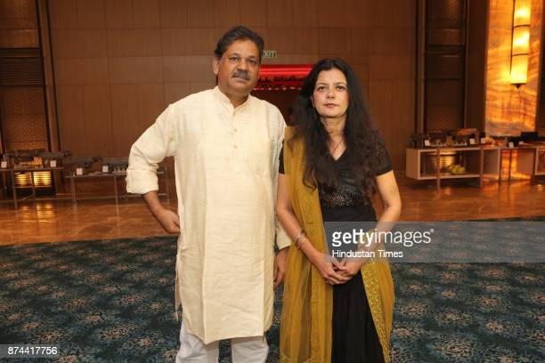 Former Cricketer Kirti Azad with his wife Poonam Azad during the wedding reception party of Cricketer Yashpal Sharma's daughter Preeti Sharma and...