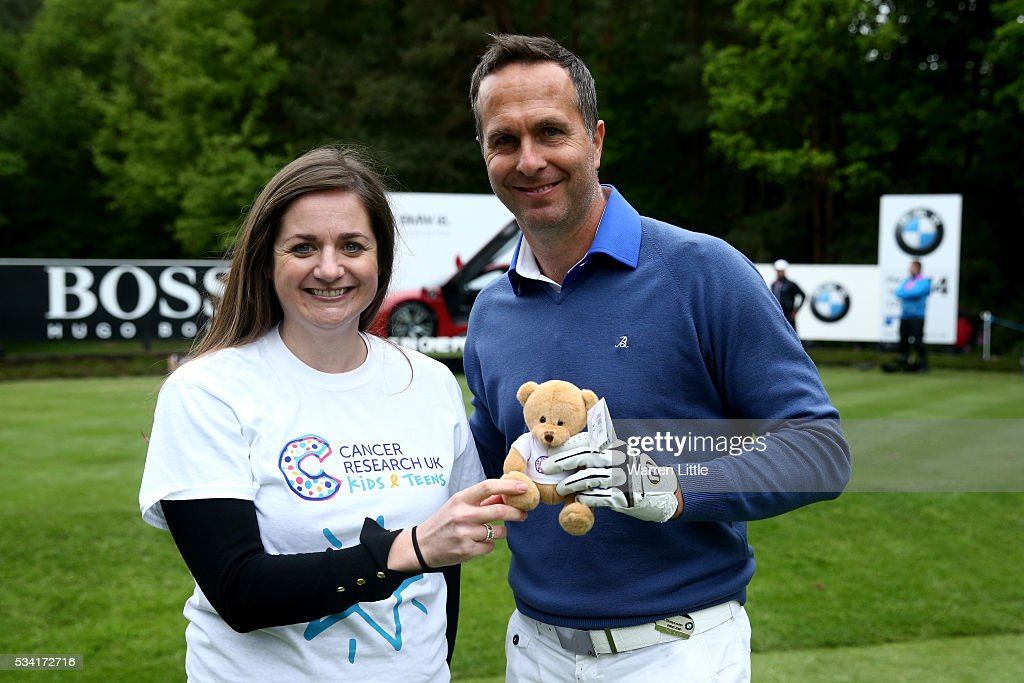 Former cricketer Michael Vaughan poses with a volunteer from Cancer Research UK during the Pro-Am prior to the BMW PGA Championship at Wentworth on May 25, 2016 in Virginia Water, England.