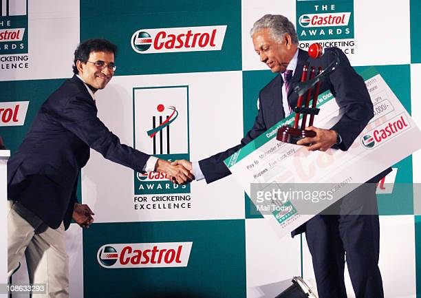 Former cricketer Mohinder Amarnath receives an award during the Castrol Awards for Cricketing Excellence in Mumbai
