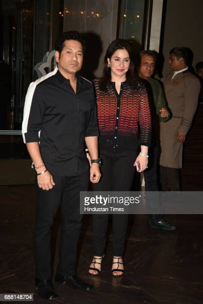 Former cricketer Sachin Tendulkar with wife Anjali Tendulkar photographed at the engagement ceremony party of cricketer Zaheer Khan and actress...