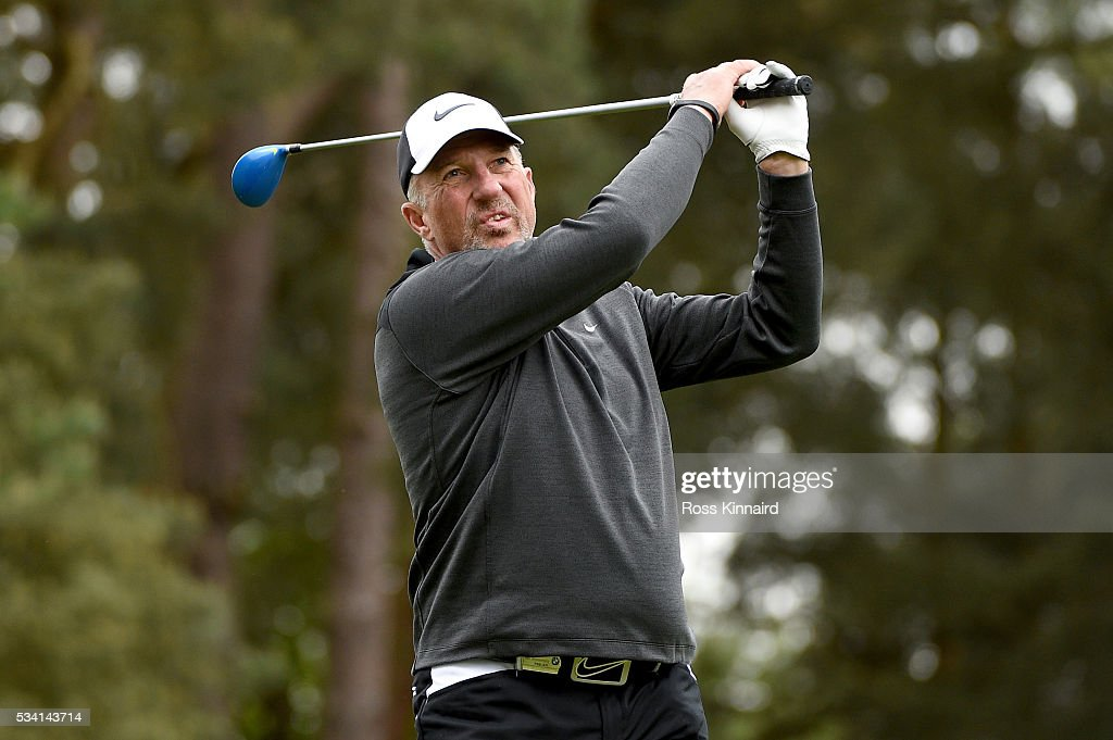 Former cricketer Sir <a gi-track='captionPersonalityLinkClicked' href=/galleries/search?phrase=Ian+Botham&family=editorial&specificpeople=207145 ng-click='$event.stopPropagation()'>Ian Botham</a> hits a shot during the Pro-Am prior to the BMW PGA Championship at Wentworth on May 25, 2016 in Virginia Water, England.