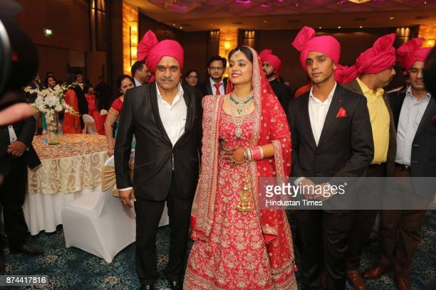 Former Cricketers Yashpal Sharmawith his Daughter Preeti Sharma during her wedding reception party at The Leela Ambience Convention Hotel Maharaja...