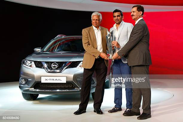 Former cricketers Zaheer Khan and Mohinder Amarnath unveil the world T20 Trophy at Nissan stall during the Indian Auto Expo in Greater Noida on the...