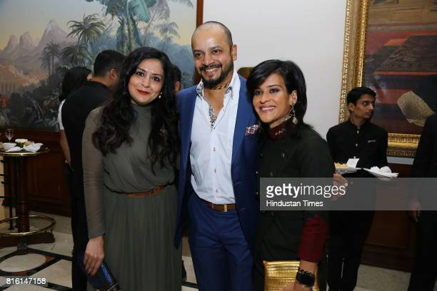 Former crickter Murali Kartik and his wife Shweta with Rima Mehra during the presentation of autumn/winter 2017 collection called 'The Regiment' by...
