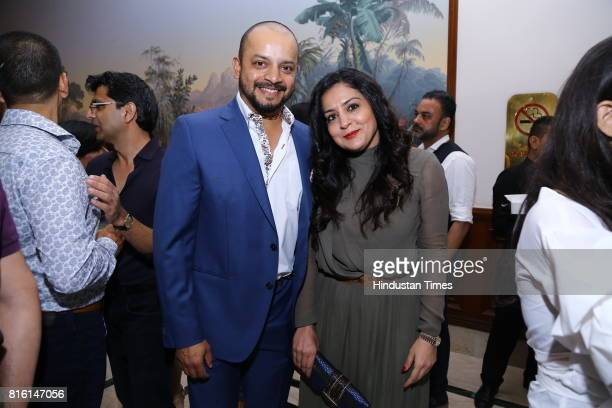 Former crickter Murali Kartik with wife Shweta during the presentation of autumn/winter 2017 collection called 'The Regiment' by designer duo...