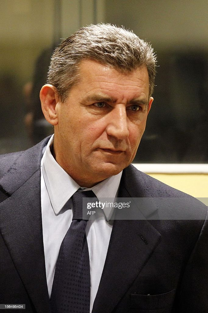 Former Croatian Army General Ante Gotovina enters the courtroom of the Yugoslav war crimes tribunal(ICTY) for his appeal judgement in The Hague, on November 16, 2012. The ICTY is delivering its decision in the appeal of two Croatian generals convicted for their roles in a 1995 military offensive to drive Serb rebels out of land they had occupied for years along part of Croatia's border with Bosnia. Ante Gotovina and Mladen Markac, were sentenced to 24 and 18 years respectively in 2011 for war crimes and crimes against humanity. The court acquitted Gotovina and Markac of charges including war crimes during the bloody breakup of Yugoslavia and ordered them freed. AFP Photo/Bas Czerwinski/ Pool/ netherlands out