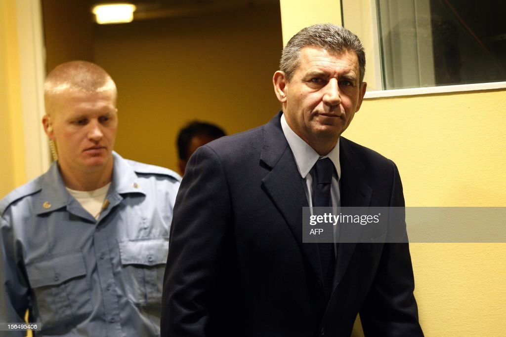 Former Croatian Army General Ante Gotovina, right, enters the courtroom of the Yugoslav war crimes tribunal(ICTY) for his appeal judgement in The Hague, on November 16, 2012. The ICTY is delivering its decision in the appeal of two Croatian generals convicted for their roles in a 1995 military offensive to drive Serb rebels out of land they had occupied for years along part of Croatia's border with Bosnia. Ante Gotovina and Mladen Markac, were sentenced to 24 and 18 years respectively in 2011 for war crimes and crimes against humanity. The court acquitted Gotovina and Markac of charges including war crimes during the bloody breakup of Yugoslavia and ordered them freed. AFP Photo/Bas Czerwinski/ Pool/ netherlands out