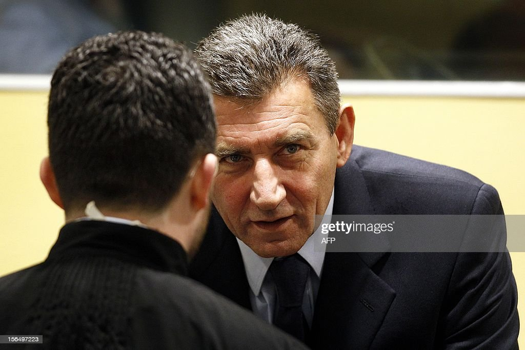 Former Croatian Army General Ante Gotovina speaks with his lawyer in the courtroom of the Yugoslav war crimes tribunal(ICTY) for his appeal judgement in The Hague, on November 16, 2012. The ICTY is delivering its decision in the appeal of two Croatian generals convicted for their roles in a 1995 military offensive to drive Serb rebels out of land they had occupied for years along part of Croatia's border with Bosnia. Ante Gotovina and Mladen Markac, were sentenced to 24 and 18 years respectively in 2011 for war crimes and crimes against humanity. The court acquitted Gotovina and Markac of charges including war crimes during the bloody breakup of Yugoslavia and ordered them freed. AFP Photo/Bas Czerwinski/ Pool/ netherlands out