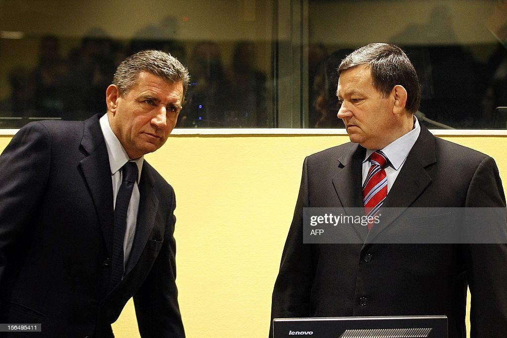 Former Croatian Army Generals Ante Gotovina, left, and Mladen Markac, right, enter the courtroom of the Yugoslav war crimes tribunal (ICTY) for their appeal judgement in The Hague, on November 16, 2012. The ICTY is delivering its decision in the appeal of two Croatian generals convicted for their roles in a 1995 military offensive to drive Serb rebels out of land they had occupied for years along part of Croatia's border with Bosnia. Gotovina and Markac, were sentenced to 24 and 18 years respectively in 2011 for war crimes and crimes against humanity. The court acquitted Gotovina and Markac of charges including war crimes during the bloody breakup of Yugoslavia and ordered them freed. AFP Photo/Bas Czerwinski/ Pool/ netherlands out