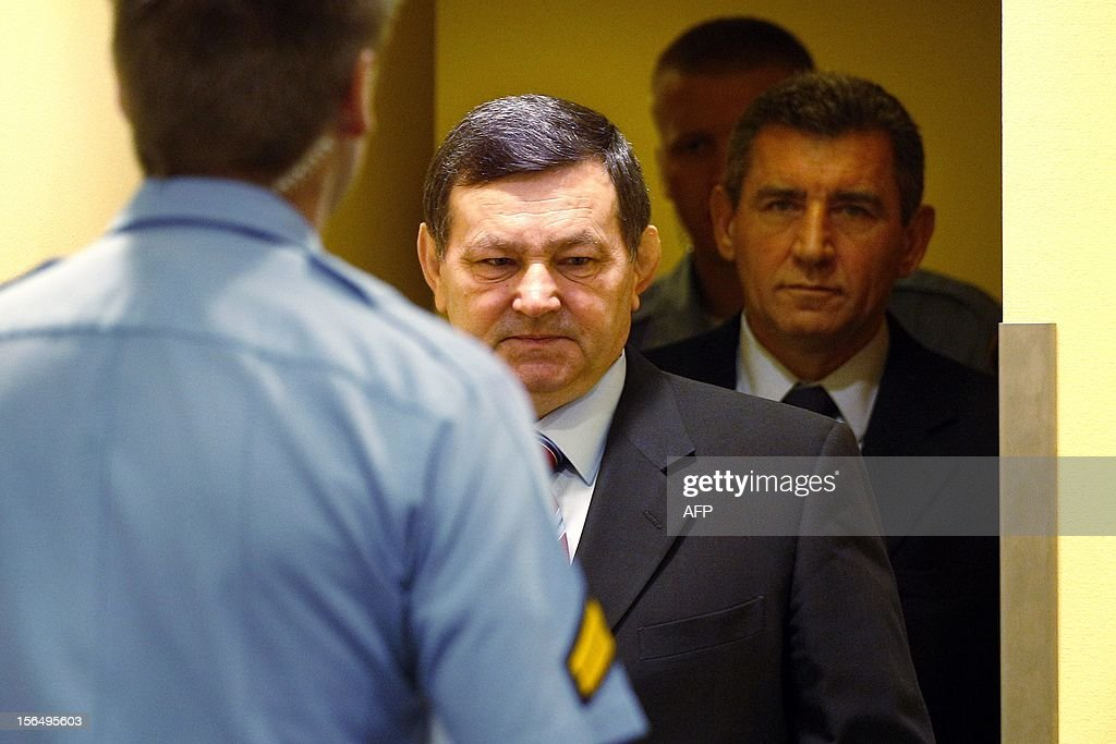 Former Croatian Army Generals Ante Gotovina, right, and Mladen Markac, left, enter the courtroom of the Yugoslav war crimes tribunal (ICTY) for their appeal judgement in The Hague, on November 16, 2012. The ICTY is delivering its decision in the appeal of two Croatian generals convicted for their roles in a 1995 military offensive to drive Serb rebels out of land they had occupied for years along part of Croatia's border with Bosnia. Gotovina and Markac, were sentenced to 24 and 18 years respectively in 2011 for war crimes and crimes against humanity. The court acquitted Gotovina and Markac of charges including war crimes during the bloody breakup of Yugoslavia and ordered them freed. AFP Photo/Bas Czerwinski/ Pool/ netherlands out