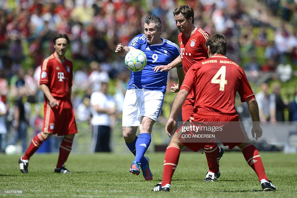 Former Croatian player Davor Suker (C) plays the ball during a friendly game between the World All-Stars and FC Bayern All Stars and Friends at the Olympiastadion in Munich, southern Germany, on May 19, 2012 as part of festivities ahead of the UEFA Champions League final football match FC Bayern Muenchen vs Chelsea FC.