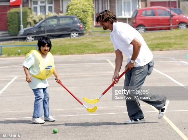 Former Croatian tennis star Goran Ivanisevic plays hockey with Kirandeep at St Albans church of England School in Birmingham for the launch of the...