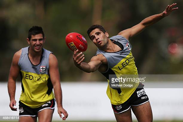 Former Crows player Jared Petrenko marks the ball against Darren Michington during a StKilda Saints AFL media session at Linen House Oval on November...