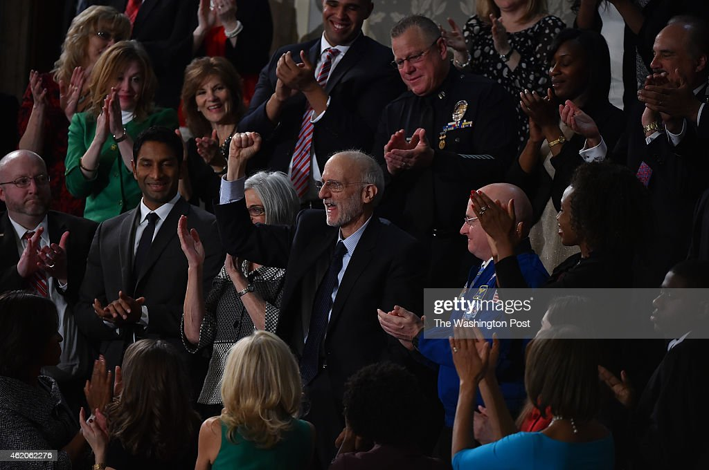 Former Cuban prisoner Alan Gross reacts as President Barack Obama references his ordeal as he delivers his State of the Union address before a joint session of Congress on Tuesday, January 20, 2015 in Washington, DC..