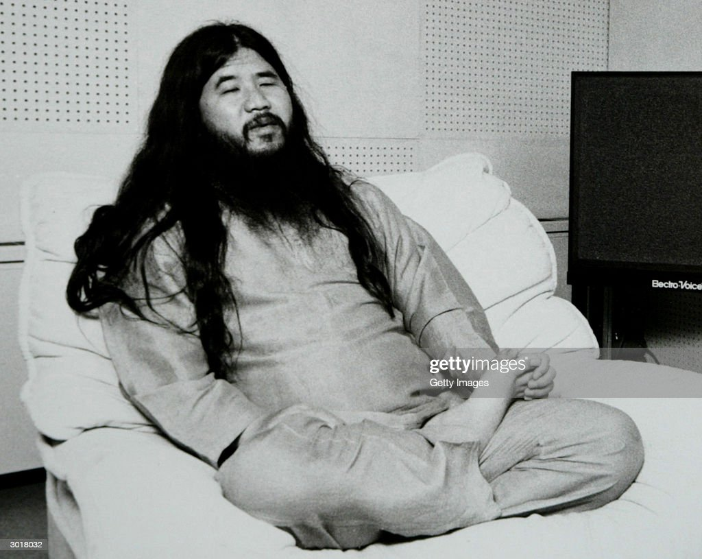 PHOTO - Former cult leader <a gi-track='captionPersonalityLinkClicked' href=/galleries/search?phrase=Shoko+Asahara&family=editorial&specificpeople=773287 ng-click='$event.stopPropagation()'>Shoko Asahara</a>, accused of masterminding the 1995 Sarin gas attack on Tokyo's subway in which 12 people died and a further 5,000 were poisoned, is seen in this undated photo. A Tokyo court is expected to render its verdict on the subway attack and other crimes February 27, 2004 after a marathon 8-year-long trial. Asahara could get the death penalty if found guilty.