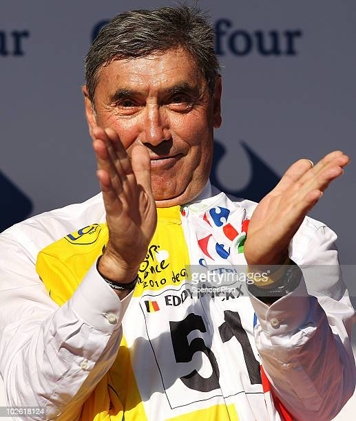 Former cycling champion Eddy Merckx stands on stage following stage one of the Tour de France July 4 2010 in Brussels Belgium Merckx is celebrating...