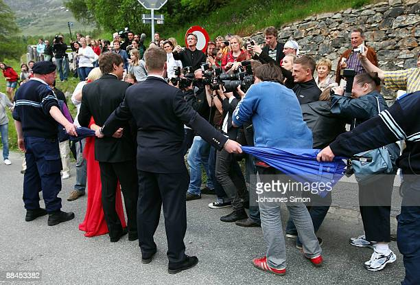 Former cycling professional Jan Ullrich and his wife Sara Ullrich are shielded against photographers leaving the Regina Pacis Chapel after the church...