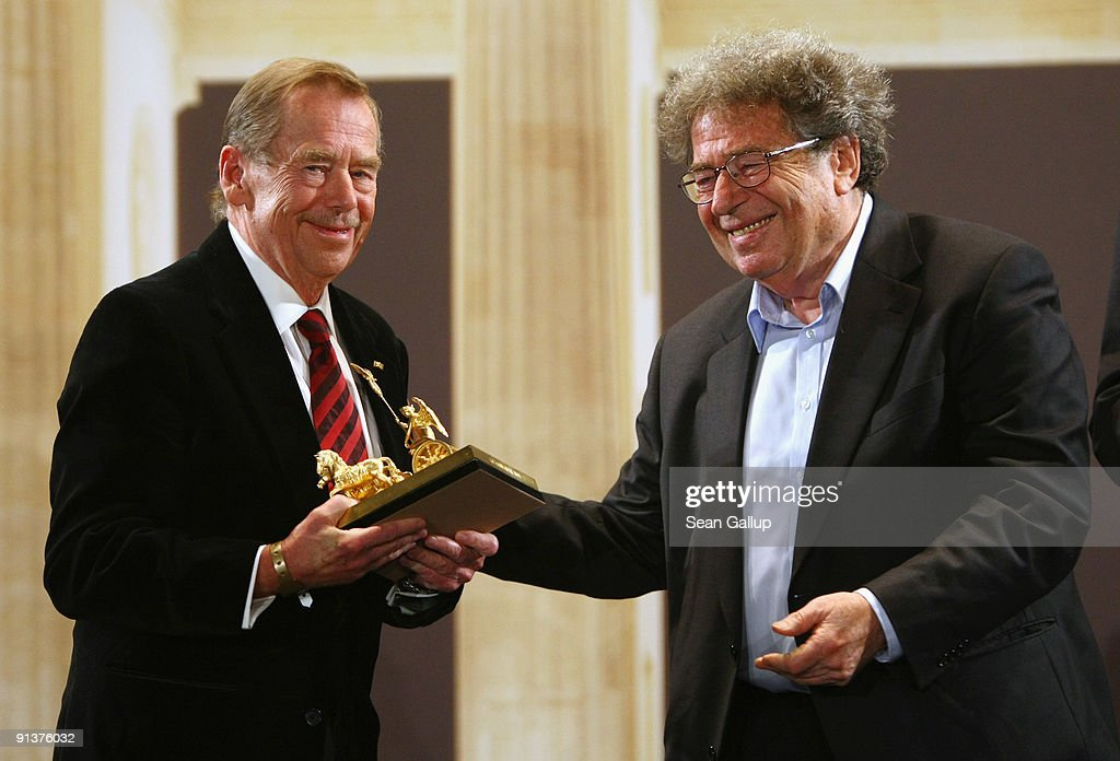 Former Czech President <a gi-track='captionPersonalityLinkClicked' href=/galleries/search?phrase=Vaclav+Havel&family=editorial&specificpeople=202931 ng-click='$event.stopPropagation()'>Vaclav Havel</a> (L) holds his Quadriga Award that he received from Gyorgy Konrad at the 2009 Quadriga Awards on October 3, 2009 in Berlin, Germany.