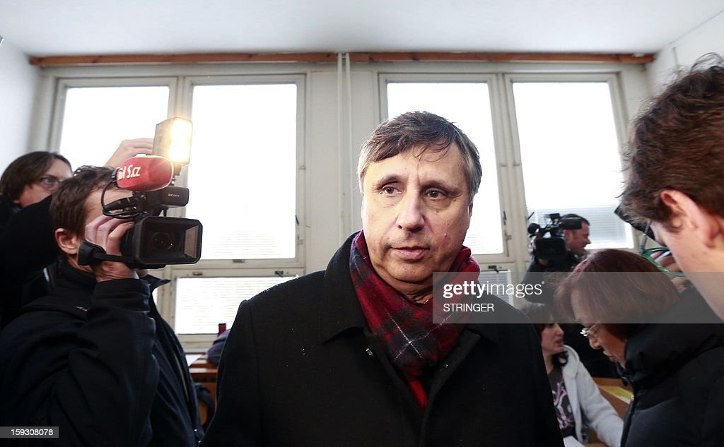 Former Czech Prime Minister and Presidential candidate Jan Fischer leaves a polling station in Prague on January 11, 2013. Czech polling stations opened on January 11 afternoon in local mid-time for the first round of the first Czech direct presidential election in history.