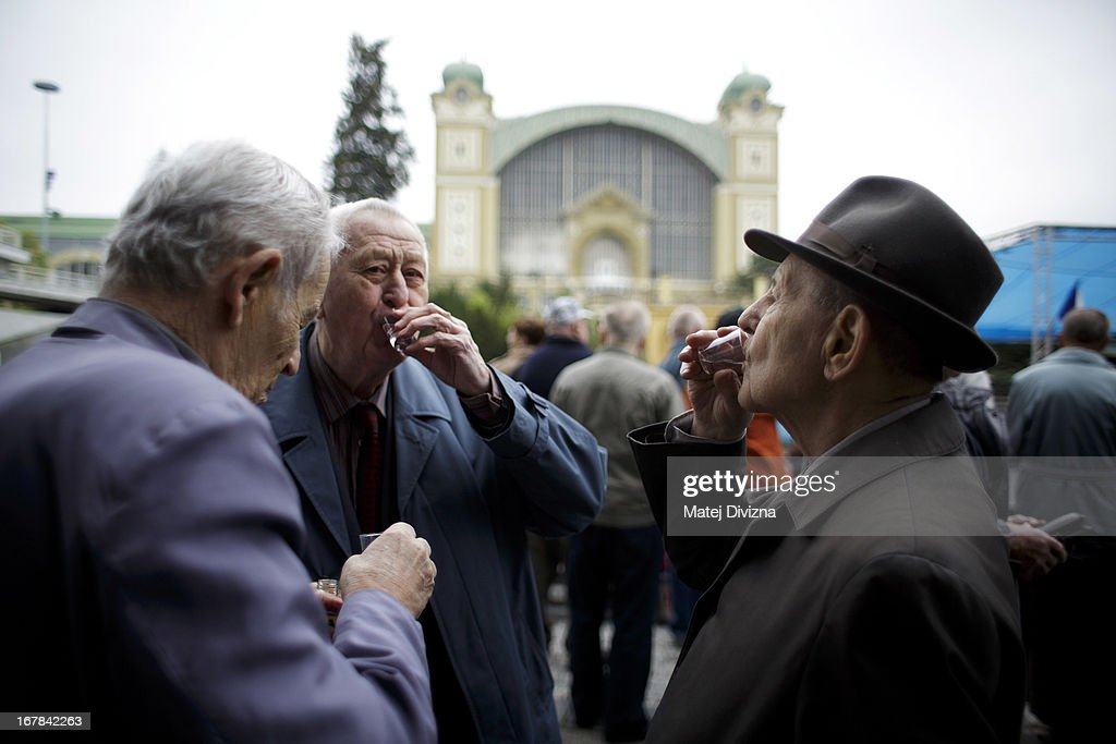 Former Czechoslovakian Communist Party chief Milos Jakes (R) drinks shot during the May Day celebration organized by Czech communist party (KSCM) on May 1, 2013 in Prague, Czech Republic. In addition to celebrations across the globe of the beginning of spring throughout the world, workers are gathering in city centers to annually vent their grievances and support their worker's unions.