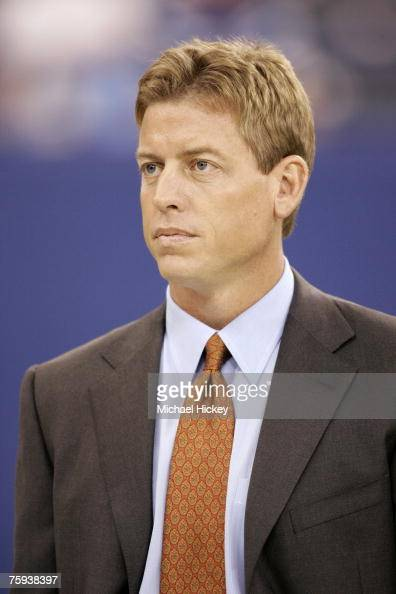 Former Dallas Cowboy quarterback and current Fox commentator Troy Aikman watches pregame warmups of the Indianapolis Colts and Green Bay Packers