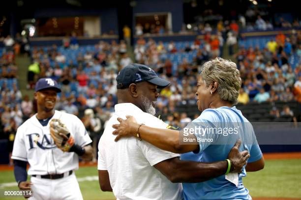 Former Dallas Cowboys running back Emmitt Smith surprises his sister Marsha SmithHill moments after SmithHill threw out the ceremonial first pitch...