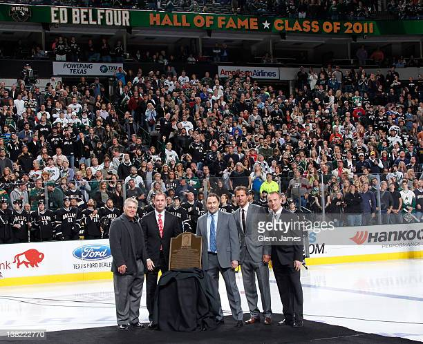 Former Dallas Star and Hockey Hall of Fame Class of 2011 inductee Ed Belfour is honored during a pregame ceremony by former teammates Brett Hull Joe...