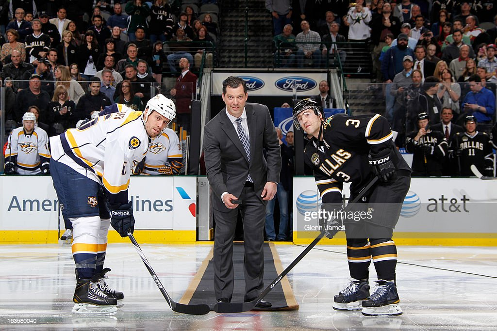 Former Dallas Star Bill Guerin drops the first puck along with Shea Webber of the Nashville Predators and Stephane Robidas of the Dallas Stars at the...
