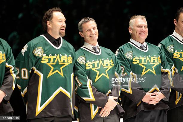 Former Dallas Stars Ed Belfour Guy Carbonneau and Brett Hull were present to see their teammate Mike Modano's be retired prior to a game against the...
