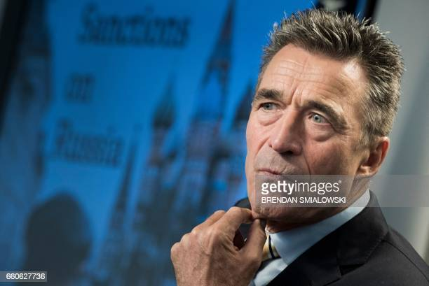 Former Danish Prime Minister and former Secretary General of NATO Anders Fogh Rasmussen listens during a forum about sanctions on Russia at the...