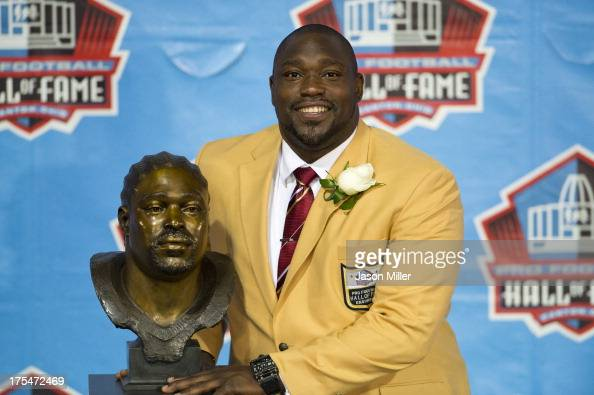 Former defensive tackle Warren Sapp of the Tampa Bay Buccaneers poses with his Hall of Fame bust during the NFL Class of 2013 Enshrinement Ceremony...