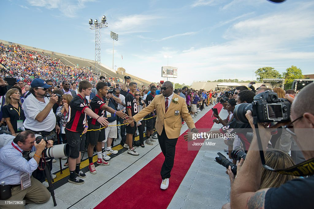 Former defensive tackle Warren Sapp of the Tampa Bay Buccaneers walks the red carpet during the NFL Class of 2013 Enshrinement Ceremony at Fawcett Stadium on Aug. 3, 2013 in Canton, Ohio.