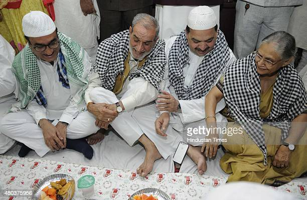 Former Delhi CM Sheila Dikshit Congress Leader Sajjan Kumar Former MLA Mateen Ahmad DPCC President Ajay Makan and other leaders during the Iftar Roza...