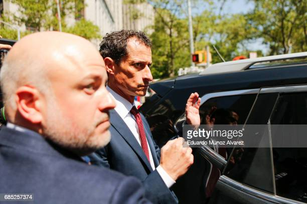Former Democratic Congressman Anthony Weiner tries to get into his car while he exits federal court in Manhattan after pleading guilty in sexting...