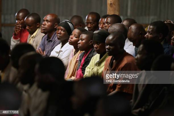 Former Democratic Forces for the Liberation of Rwanda combatants and local people attend a Ibiganiro byo Kwibuka or 'Meeting of Remembering' at the...
