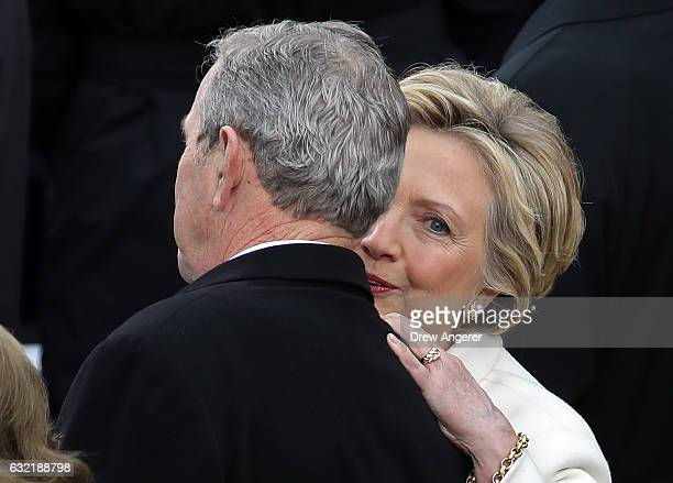 Former Democratic presidential nominee Hillary Clinton talks to former President George W Bush arrives on the West Front of the US Capitol on January...