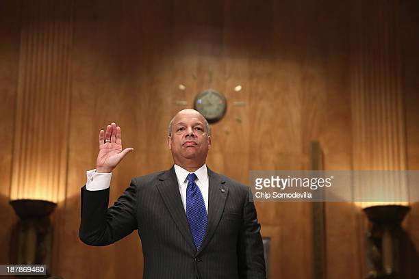 Former Department of Defense General Counsel Jeh Johnson is sworn in before testifying to the Senate Homeland Security and Governmental Affairs...